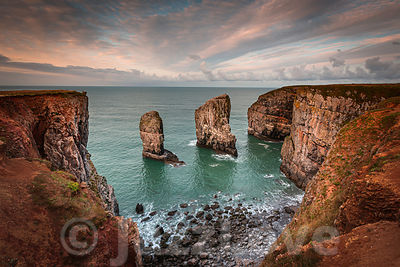 Stack rocks photographed at sunrise on dramatic coastline of Pembrokeshire ,South Wales,UK