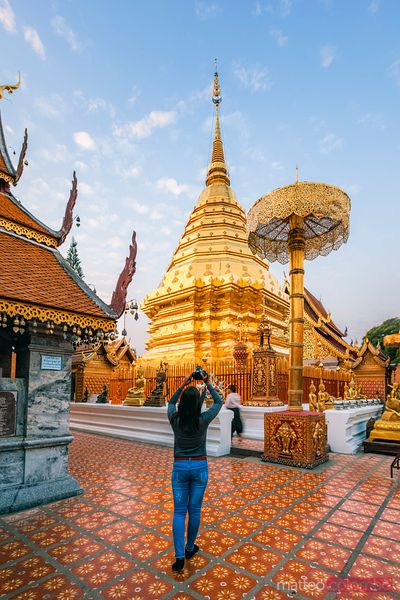 Woman photographing at Wat Phra That Doi Suthep, Chiang Mai, Thailand
