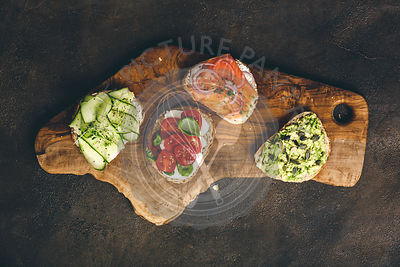 Variety of sandwiches for breakfast, snack, appetizers - avocado puree, mozzarella, tomatoes, basil, cream cheese, smoked sal...