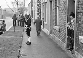 #77105,  The 'Nutters' Dance', Bacup, Lancashire,  1973.  On Easter Saturday every year the 'Coconut Dancers' gather at one b...