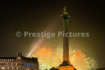 London Fireworks 2020 on News Years Eve as seen from Trafalgar Square - yellow sky
