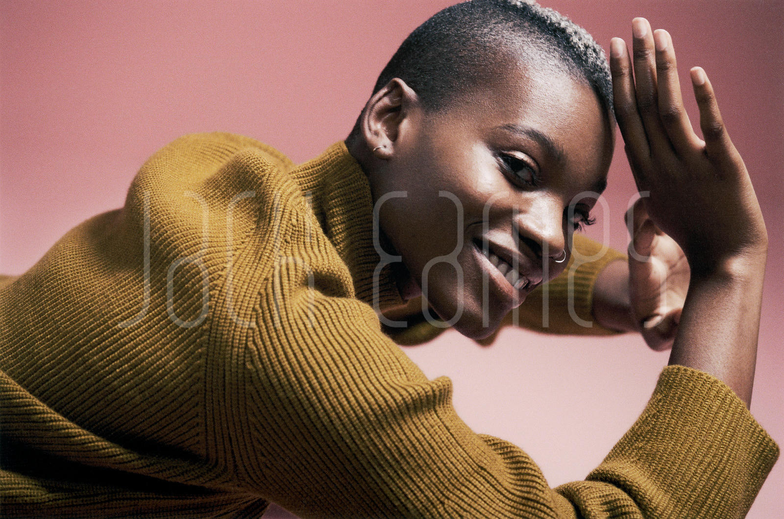 A Beautiful Young Black Woman With Shaved Hair Dancing Joyously In The Studio
