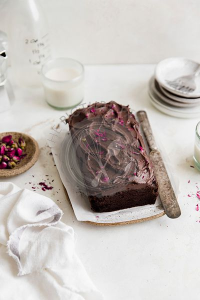Double Chocolate Loaf with chocolate frosting and rose petals