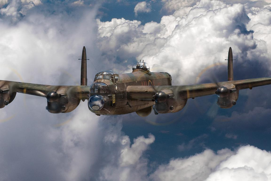 Avro Lancaster above clouds close-up