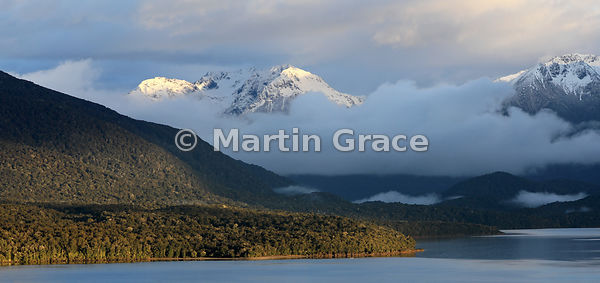 Murchison Mountains at sunrise with native forest of foothills of Kepler Mountains, from Te Anau, Fiordland National Park, So...