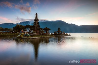Temple on the lake at sunset, Bali, Indonesia