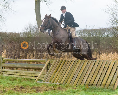 Jamie Collie jumping a hunt jump after the meet