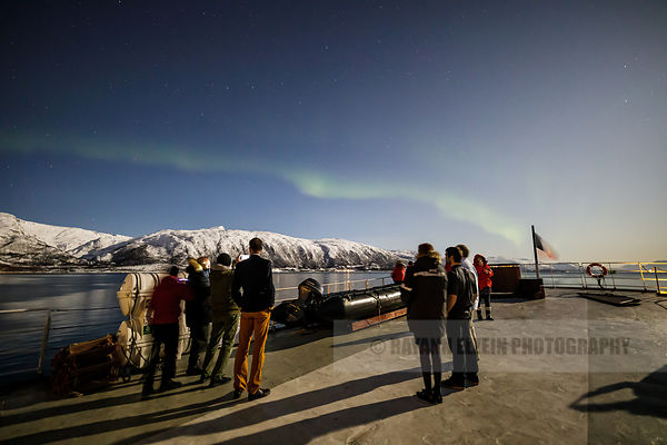 Group of tourists under the northern lights, Polarfront ship, Norway