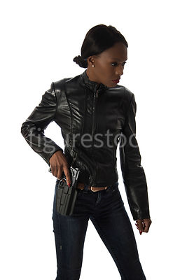 A tough woman, in a leather jacket - shot from eye level.