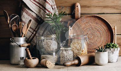 Eco-friendly kitchen concept: Kitchen cooking utensils, house plants and cooking ingredients  in glass jars against rustic ki...