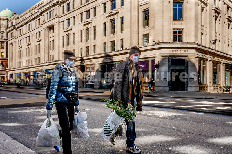 Shoppers in London wearing protective face masks