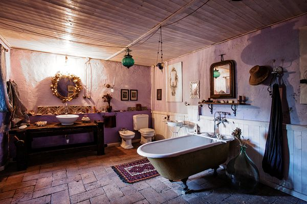 The bathroom used to be a storage room. The old bathtub is from a shop that sells construction material. The carpenter's tabl...