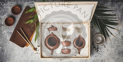 Tea set in the box on concrete background