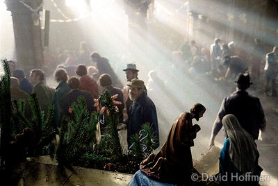 Homeless people line up for their Christmas dinner at an open shelter in a disused church run by charity Crisis at Xmas