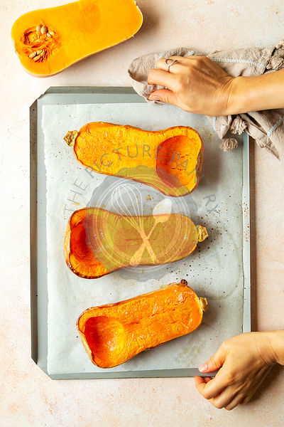 Roasted butternut pumpkin on a baking tray.