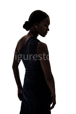 A silhouette, of a woman in a dress – shot from eye level.