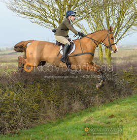Heidi Coy jumping a hedge at Sheepwash