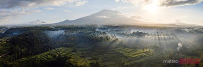 Panoramic of volcano and mist filled valley, Bali
