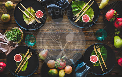 Autumn table styling with black dinnerware and leaves for decoration