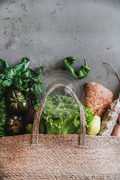 Flat-lay of healthy grocery shopping bag with fresh ingredients