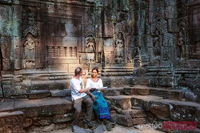 Man and woman inside a temple, Angkor, Cambodia