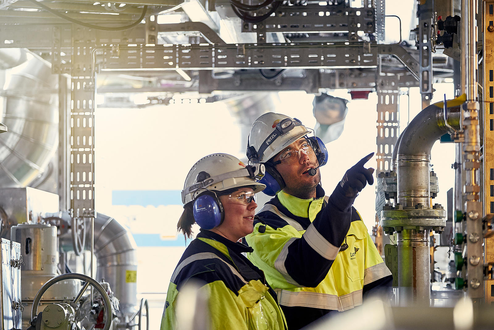Workers at the Edvard Grieg oil rig