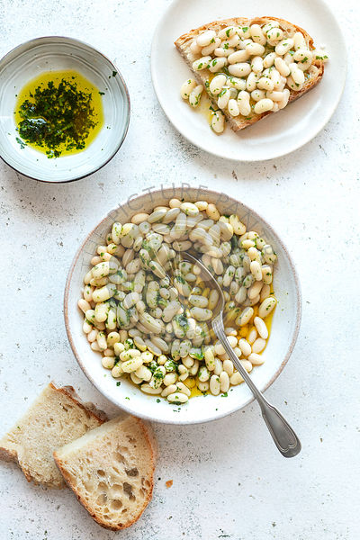 Creamy white bean with herb oil on the table,top view