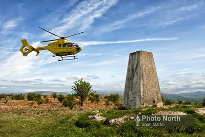 HUTTON ROOF 47A - Air ambulance over Hutton Roof Crags trig point