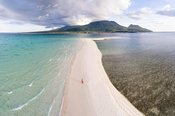 Woman walking on White island, Camiguin, Philippines