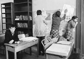 #75026  Decorating the walls with pages from a wallpaper catalogue, Liverpool Free School, Liverpool  1971.  Also known as th...