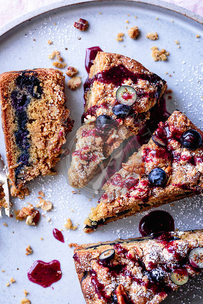 Pieces of blueberry coffee cake on a plate.