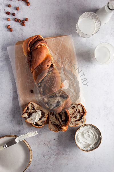 Chocolate and hazelnut babka served with cream cheese.