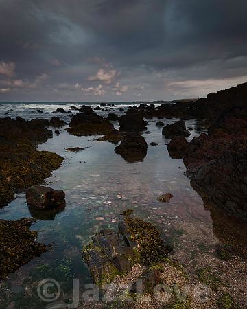 Beautiful twilight scene on  rocky beach during low tide in Freshwater West, Pembrokeshire, South Wales,UK.