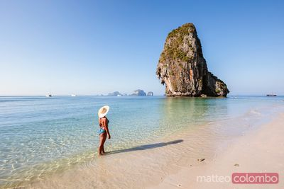 Woman with straw hat at Phra Nang beach, Railay, Thailand