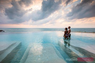 Man and woman in an infinity pool at sunset, Ko Samui, Thailand