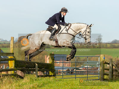 Meghan Healy jumping a fence at Deane Bank - The Cottesmore Hunt at Owston 19/11