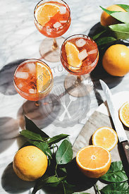 Aperol Spritz cocktail in glasses with orange and ice cubes