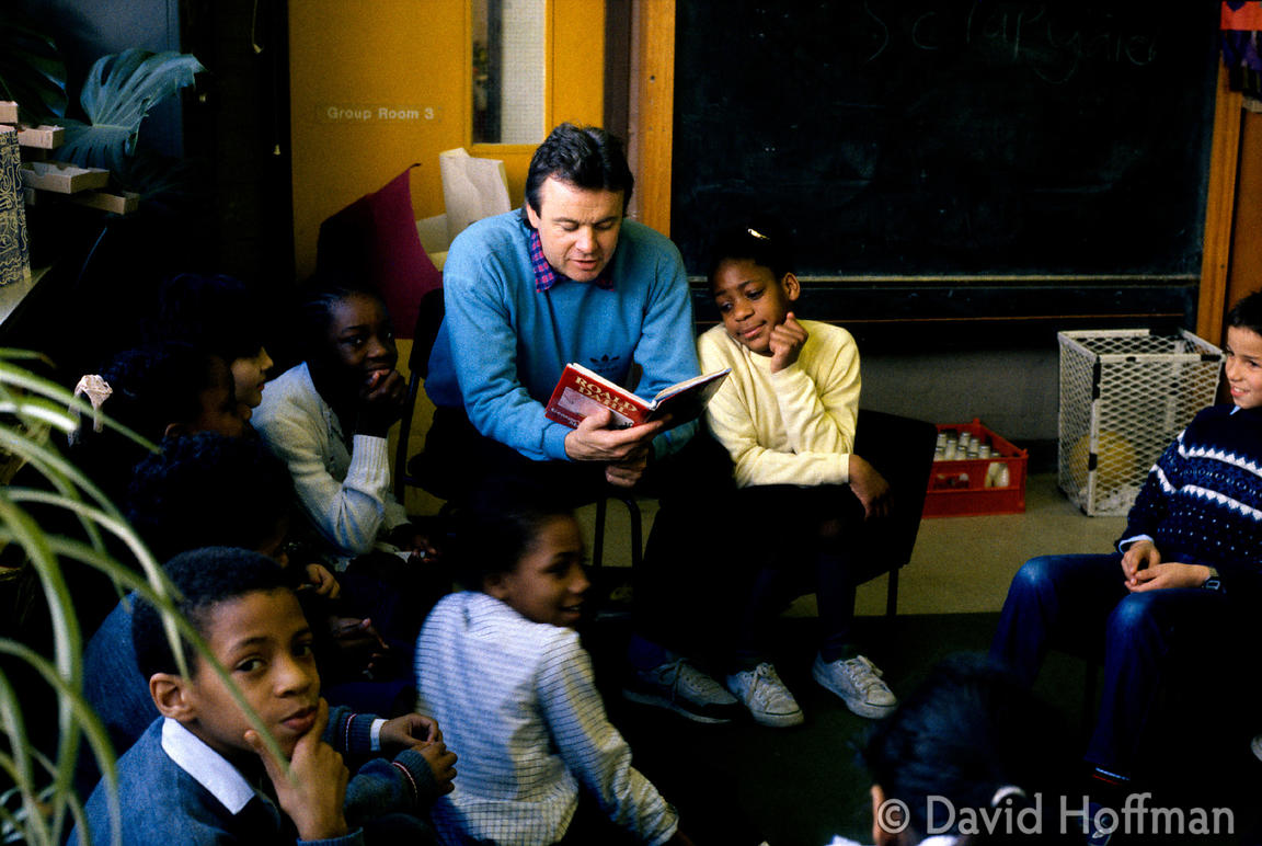 Reading To Class 2 Teacher reading to children at Newfields Primary School, Brent.