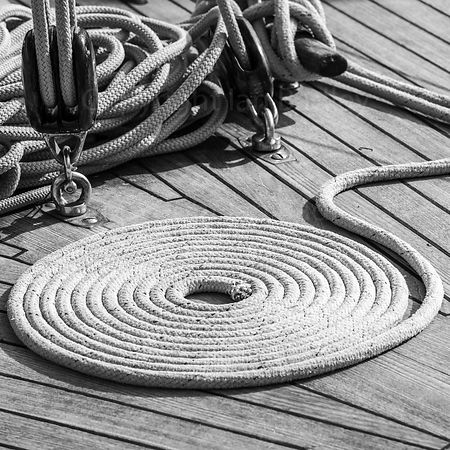 Classic yacht wall art of coiled rope on wooden deck