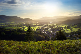 Sunrise over the small town of Braithwaite and surrounding mountains in the Lake District, England.