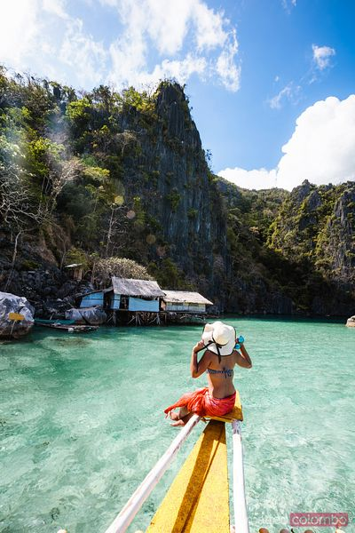 Woman on boat at the lagoon, Coron, Palawan, Philippines