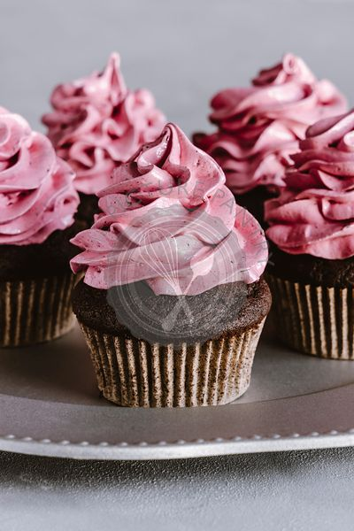 Chocolate cupcake with black currant marshmallow frosting.Chocolate cupcake with black currant marshmallow frosting.