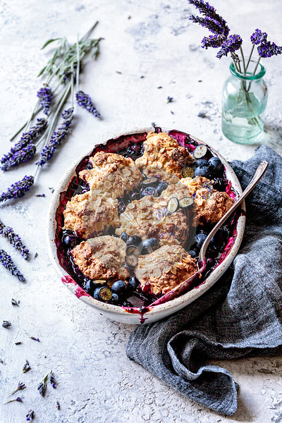 Blueberry cobbler with oat biscuits and lavender.