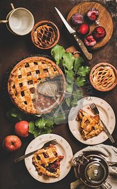 Flat-lay of apple and plum pie on rack with tea
