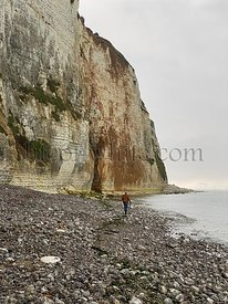 Veulettes-sur-Mer, France, August 16, 2020 - Unrecognizable people taking a walk close to the dangerous cliff of the opal coast