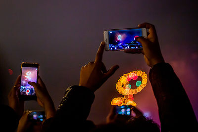Smart phones photographing the spectacular firework display in London for 2019