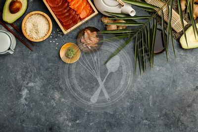 Overhead shot of ingredients for sushi on dark blue background