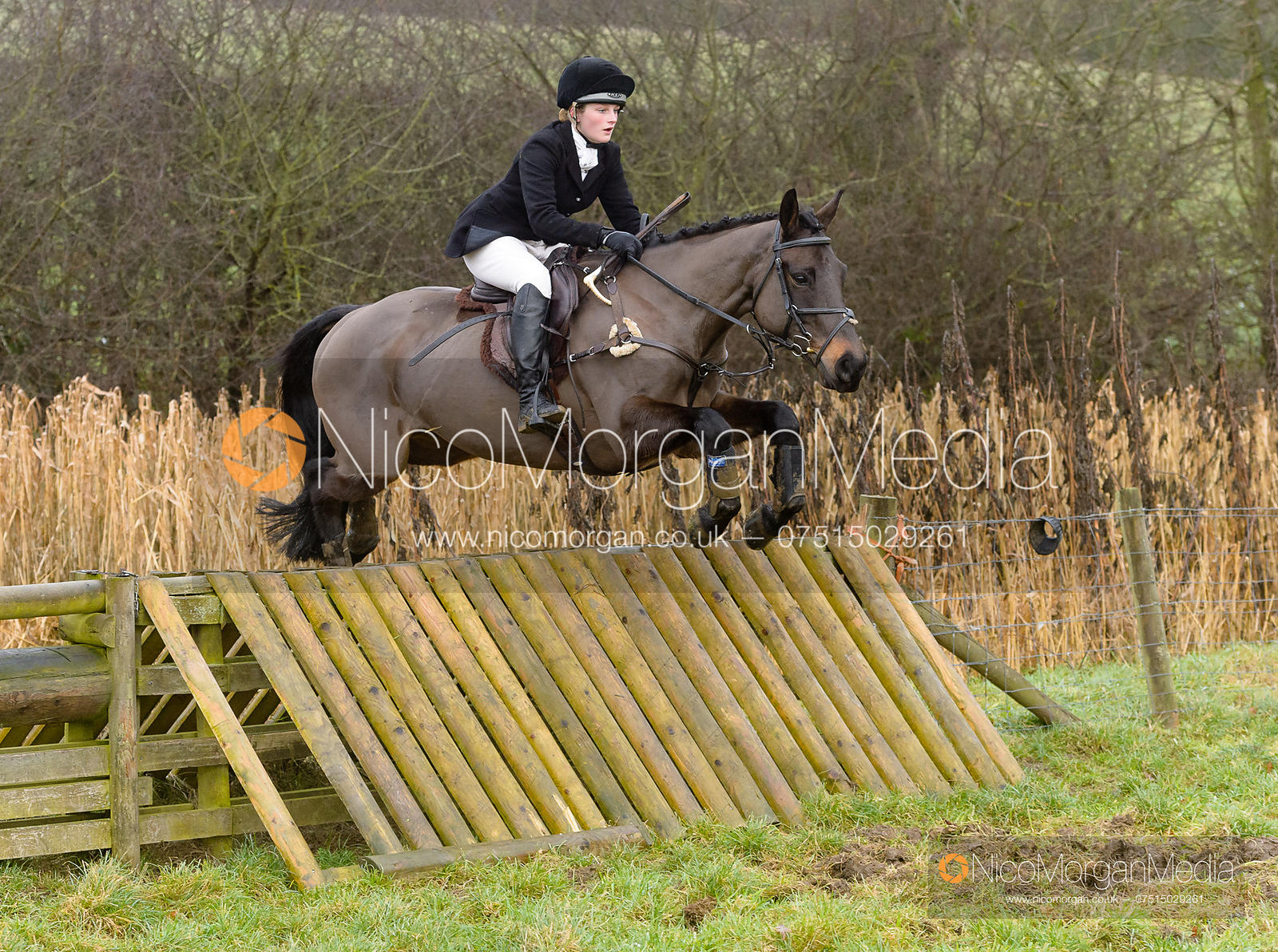 Hermione Brooksbank jumping a hunt jump at Peakes - The Fitzwilliam Hunt visit the Cottesmore at Burrough House