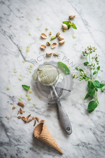 Pistachio Ice Cream with scoop in a rustic bowl