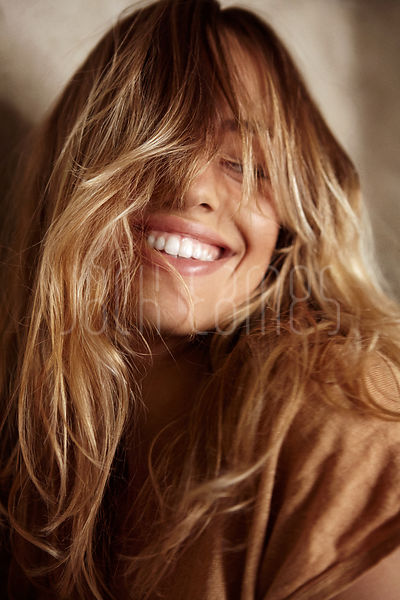 Beautiful Blonde Smiling Woman With Hair Covering Her Face